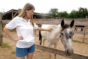 Rebecca Williams rubs Mara