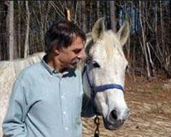 Bruce Wagman with rescued horse Lacy .