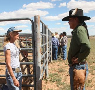 Navajo activist Leland Grass (right) confronts horse buyer Jeanne Collom.
