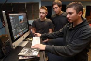 From left, Tyler Hersh, of Absecon, Joe Parisi, of Egg Harbor Township, and Eric Klein, of Cherry Hill, work on a documentary about the slaughter of wild horses in the west at the Charter Tech High School, in Somers Point.
