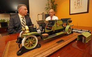 A model of the faux-vintage electric car that horse advocates say could replace carriage horses in New York, with Ed Sayres, left, and Steve Nislick of NY-Class, the group that sponsors the cars - NY Times