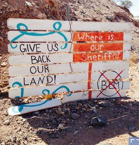 A sign on the highway just outside Cliven Bundy's Bunkerville, Nev., ranch. The federal government has completely pulled out of the area. Kirk Siegler/NPR