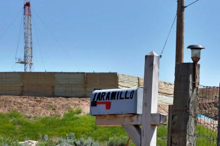 The mailbox of New Castle, Colo., resident Joann Aramillo stands a few hundred yards from an oil and gas rig on a well pad. Four in 10 high-priority oil and gas wells are not checked by BLM, the Associated Press says. (Brennan Linsley/The Associated Press)