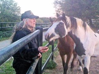 Willie Nelson with his rescued horse Voodoo