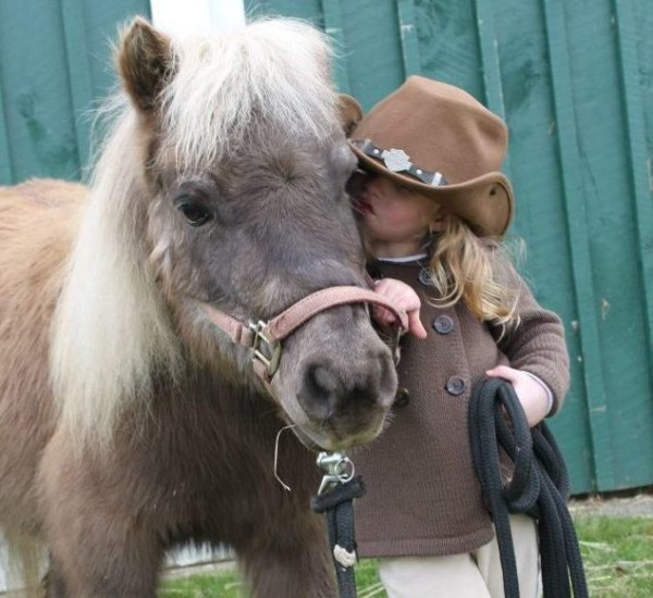 A cowgirl and her pony...