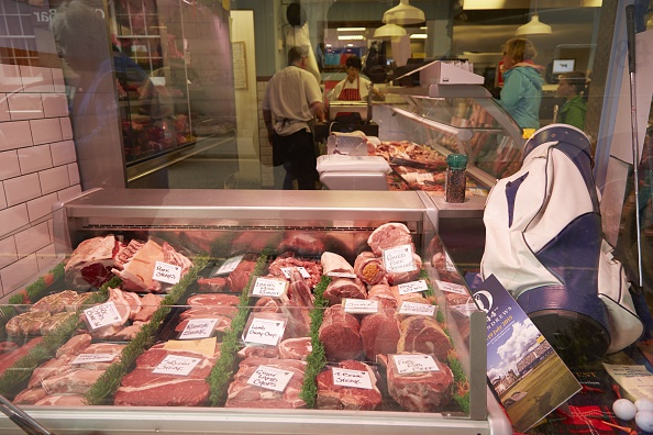 Golf: British Open Preview: View of butcher storefront in town displaying golf bag and clubs alongside meat on Monday at Minick of St Andrews.  St. Andrews, Scotland 7/13/2015 CREDIT: Erick W. Rasco (Photo by Erick W. Rasco /Sports Illustrated/Getty Images) (Set Number: X159778 TK1 )